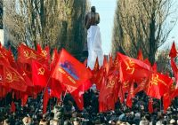 Supporters of the Ukrainian Communist Party wave various communist party flags during the opening ceremony of Soviet founder Vladimir Lenin monument in Kiev, Ukraine, Friday, Nov. 27, 2009. The monument was damaged in June 30, 2009, by activists of Ukrainian nationalist organization that has been pushing for removing all Soviet monuments from the country. (AP Photo/Efrem Lukatsky)